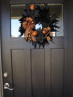 Opulent  Black and Orange Halloween Feather Wreath / Halloween Front Door Decor. $60.00, via Etsy.