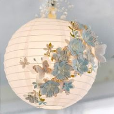 DIY paper lamp Ever wondered how to make one of those cute and fun paper pendants? With a few paper flowers, butterflies, and beads you'll make the best paper lamp ever! Chandelier Lamp, Ceiling Lamp, Chandelier Ideas, Chandeliers, Flower Decorations, Wedding Decorations, Aisle Decorations, Party Decoration, Diy Paper