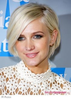 Ashlee Simpson's platinum crop - cute, almost asymmetrical bob - if I had the guts to chop my hair off.......
