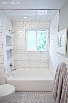 I love this white tiled bathroom with grey walls!  4 Men 1 Lady