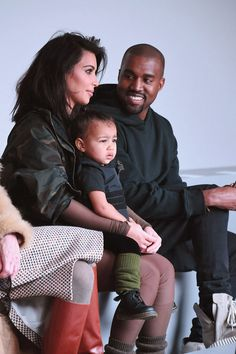 Kim Kardashian and Kanye West pose with daughter North West at New York Fashion Week. Go inside West's show here: