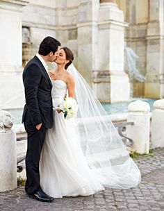 Groom in a Prada suit and bride in a Reem Acra gown.  Rome wedding. gorgeous trevi fountain