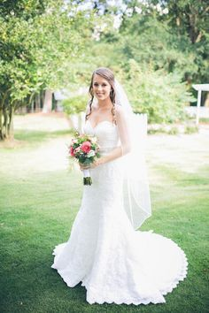 Strapless sweetheart fit-and-flare lace wedding dress featuring a jeweled belt and a ballet length veil {Brandy Angel Photography}