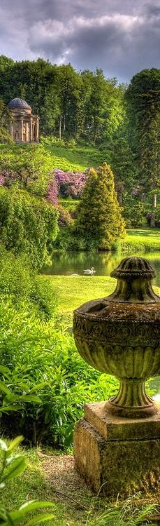 Stourhead - near Mere, Wiltshire, England. The 1,072-hectare estate has gardens designed by Henry Hoare II laid out between 1741 and 1780 in a classical 18th-century design. As a collector of art – one of Henry's pieces was Nicolas Poussin's Aeneas at Delos, which is thought to have inspired the pictorial design of the gardens and passages telling of Aeneas's journey are quoted in the temples surrounding the lake. Many of the temples are inspired by scenes of the Grand Tour of Europe.