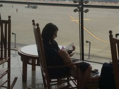 Reading and rocking while waiting for a plane at the Seattle Airport in Washington.