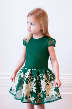 Let your fashionista put her best foot forward with our jade green and gold flower dress. The David Charles A/W16 edit is here and this visually stunning staple is already proving to be a winner with little girls everywhere. This particular gown is simply ideal to wear for ballet evenings, pageants and ballroom events. Available in a refreshing jade green shade, note how the gold floral embroidered skirt adds some serious sophistication into the mix for when your princess really needs to…