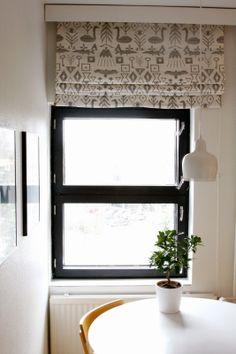 Kitchen curtain by Saana & Olli Maailman synty fabric.
