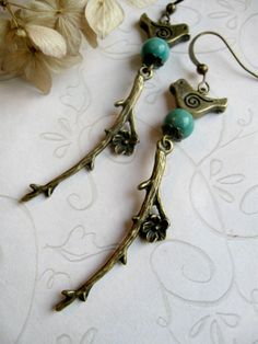 Long branch earrings bird brass charms turquoise I like the branch part but not so much the bird.