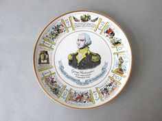 Vintage Lord Nelson Pottery Plate - Georg Washington | collectible plate, decorative plate, americana decor, 1976 bicentennial plate  ~Details~ Great Americana decorative plate - celebrating George Washington as the Nations First President and the 1976 Bicentennial. Plate was manufactured by Lord Nelson Pottery in England. Its a white base plate with multicolored design and a gold rim. Portrait of George Washington in the center and other scenes from American history encircle the rim…