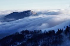 Clouds flowing over ridge down to the valey during temperature inversion.