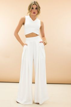 Don't like how gouchy these are. I like wide leg but fitted in tush and hips, and not pleats Raya High-Waisted Wide-Leg Pants - White | Haute & Rebellious