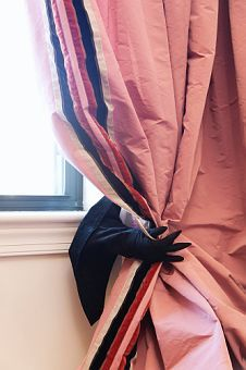 Awesome tieback for Halloween curtains.