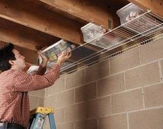 Short on storage space? Have an unfinished basement ceiling? Here is a really inexpensive way to add some storage space...get the wire shelves from walmart/lowes/kmart/home depot for around 10 bucks and you have instant extra hideaway storage spaces!