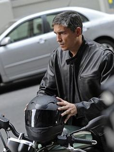 Person of Interest.  Motorcycle, jacket, helmet... wow