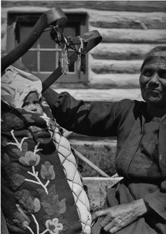 Ojibwe - Nancy Everett-Berens, (the wife of William Berens Sr.), and her grandchild in front of her home in southern Manitoba - Ojibwa (Berens River Band) - 1933