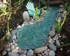 Jardín de hadas estanque Mutli color rocas burbujeante chispa