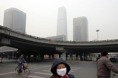 A pedestrian wearing a protective mask in Beijing, Jan. 17, 2012. Decades of coal-powered industrialization combined with the government-promoted car craze have brought China the worst air pollution in the world. (Photo: Gilles Sabrie/The New York Times)