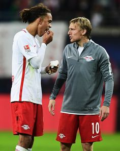 Yussuf Yurary Poulsen of Leipzig shows his loose tooth to Emil Forsberg during the Bundesliga match between RB Leipzig and FC Augsburg at Red Bull Arena on September 30, 2016 in Leipzig, Germany.