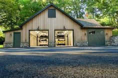 Nice garage with plenty of room and car lifts. Very cool style with rock work along the bottom of the garage. Nice garage with plenty of room and car lifts. Very cool style with rock work along the bottom of the garage. Garage Loft, Pole Barn Garage, Pole Barn Homes, Garage Shop, Garage Workshop, Garage Storage, Pole Barns, Garage Organization, Organization Ideas