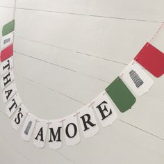 Made to Order   This listing is for one Tuscan Themed party banner. Your banner will be made with heavy card-stock, foam letters and strung on coordinating bakers twine. The banner pictured features 17 fancy pennants spelling the phrase Thats Amore. You can choose from Thats Amore, Bride to Be or Happy Birthday during checkout. The words will be separated with three stamped images of the Leaning Tower of Pisa. Each piece measures 4-1/2 X 2-3/4. A great way to set the mood for an Ita...