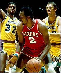 Google Image Result for http://thestartingfive.net/wp-content/uploads/2008/03/moses_malone_1983.jpg