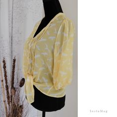 Sheer top 100% polyester, size medium.cheerful yellow top with front buttons.breezy, very light Charlotte Russe Tops
