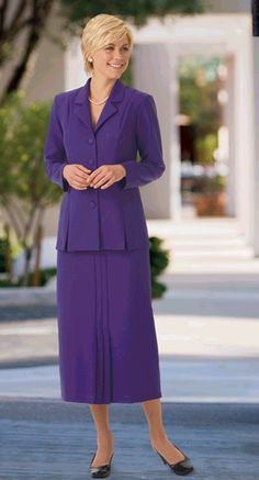 Very pretty and lovely purple skirtsuit with necklace.