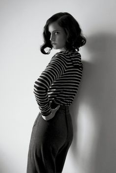 stripey top with high-waisted, wide-legged trousers