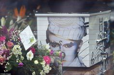 The singer's coffin was plastered with pictures of Strange from the eighties, showcasing his flamboyant, colourful style (pictured)