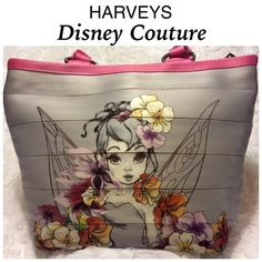"Disney Couture Tinker Bell Bag by Harvey's This Tinker Bell bag is absolutely beautiful! Made by Harvey's out of gray and pink seat belts with silver metal carriage rings, zipper pull, and feet. Harveys canvas hang tag. Interior zipper pocket and four accessory pockets. 11"" x 11"" x 6"" with a 13"" zipper closure at top. Dual seat belt handles with a 13"" drop. I purchased this at Disneyland. Only used it for a short time. It is in almost new condition with minimal signs of wear. No tears or…"