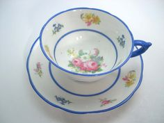Lovely tea cup and saucer from Star Paragon The backstamp date this set from 1923 - 1933 The rims, the base and the thumbrest are royal blue. The tea cup measures 2 1/8 high and the saucer measures 5 1/2 diameter. Very good conditon no chips, no cracks, no crazing but only the