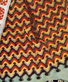Step into a time machine with this crochet blanket pattern! That Afghan is both groovy and comfortable. The chevron ripple crochet pattern that adorns this blanket makes it easy to crochet and infuses it with a mellow vibe. Crochet Fall, Crochet Home, Free Crochet, Crochet Wraps, Chevron Afghan, Crochet Ripple Afghan, Afghan Crochet Patterns, Crochet Stitches, Crochet Afgans