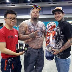 """Mithra's Tony Chow with """"Tattoo of the day"""" winner Richard De La Cruz at the Mobile Alabama Gulf Shore Tattoo Expo."""