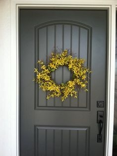 Gray door and yellow wreath...... This is my door hummmmmm just might have to do this color