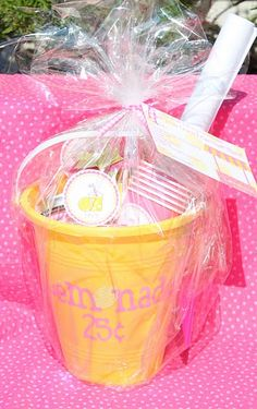 pinner says -- I picked up yellow sand buckets from the dollar store. I had to switch out the shovels so they would match my pink & green theme. I decided this would be a perfect gift for several of our friends who have summer birthdays and needed boy & girl versions.