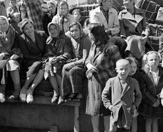 During the Second World War New Zealand invited 800 Poles – 734 of them orphaned children – to take refuge in New Zealand for the duration of the war. They had made a harrowing journey from Poland through Russia and Iran, to reach New Zealand on 31 October 1944. The photo shows some of them on board the General G. Randall on the day they arrived.