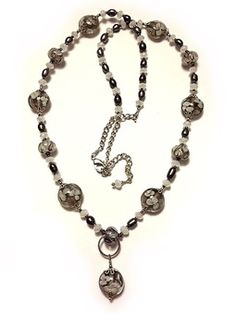 31.5 Inches Long made out of Lampwork Glass, Pearls and Crystals $65.00