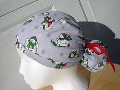 $13.99 This scrub hat has cute little WHITE SNOWMEN dressed in Warm RED and GREEN scarves and stocking hats, skiing on it. There are LT. BL...