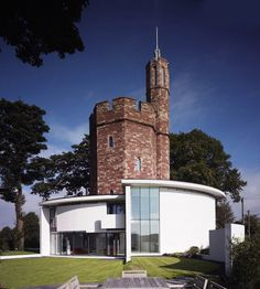 The Lymm Water Tower is an award winning renovation of a once derelict Grade II listed water tower converted into a luxurious contemporary family home. Renovated by Ellis William Architects, the octagonal stone water tower is complemented by a new modernist wrap around double height extension.