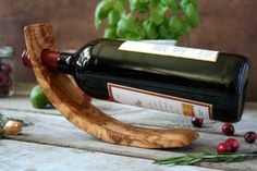 Olive wood is ideal for preparing food with its natural oil content of olive wood, it kills bacteria and is therefore more hygienic than other wooden or plastic products. This bottle holder can hold a full bottle as well as an empty bottle. Wood Wine Bottle Holder, Wood Wine Racks, Wine Rack Wall, Wine Holders, Bakers Rack Kitchen, Articles En Bois, Hanging Wine Glass Rack, Wine Rack Storage, Wood Display