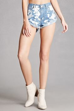 A pair of denim shorts by Pixie & Diamond™ featuring a bleach dye design, five-pocket construction, a zip fly, as well as a frayed and cuffed hem. (This item runs a half size small, please size up.)