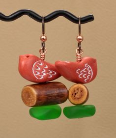 Happy Summer! Polymer clay bird by Pips Jewellery, wooden log bead and green 'see' glass on Niobium earwires with a copper bead. Week 21/22