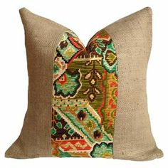 """Combining both exotic and rustic influences, this feather and down-filled pillow pairs burlap upholstery with an ikat-inspired stripe.  Product: PillowConstruction Material: Burlap, cotton and down feather fillColor: MultiFeatures: Insert includedDimensions: 20"""" x 20""""Cleaning and Care: Spot clean"""