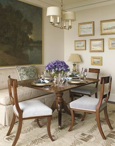 """Howard was drawn to the Oushak rug because of its quirky geometric pattern. """"It has a sixties, George Jetson-ish feel. A rug with a traditional center medallion would never have worked."""" She designed the banquette."""