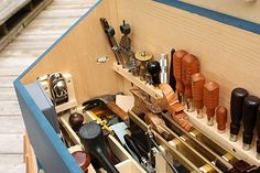 block plane on side. lots of saws.