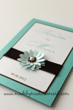 Teal black and white invitations with flower embellishment by Made by Michelle Mark