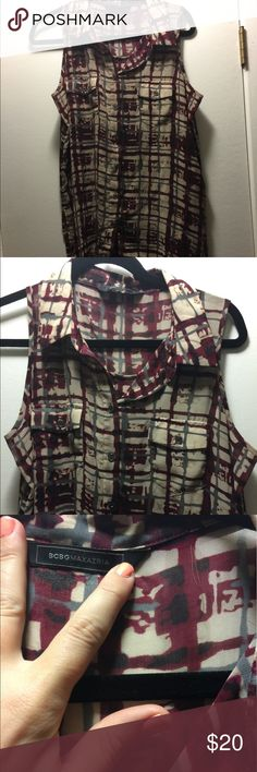 BCBG loose fitting top BCBG maroon and tan loose fitting top ⭐️👸🏻 never worn. Looks so cute on. Longer in the back. Great with skinnies, leggings, even over a dress. BCBGMaxAzria Tops Blouses
