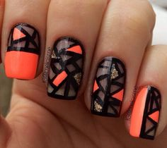 Clear nails with black, orange and gold nails. Every nail has a different print.