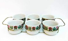 Mid century Villeroy & Boch appetizer set with 6 small bowls and a metal carrying tray. Each bowl features the same pattern  Retro set of six ceramic bowls ramekins VILLEROY & BOCH, Mid Century, oven and table, oven dishware, oven dinnerware, antique dinnerware  Perfect vintage conditions with original box. Never used before.  Fantastic for a  retro table. | Shop this product here: http://spreesy.com/VintagechicBrussels/311 | Shop all of our products at http://spreesy.com/VintagechicBrussels…