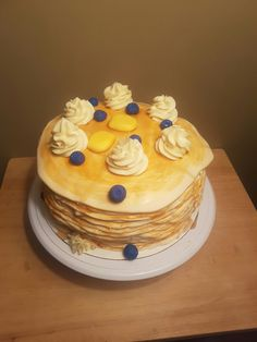"Pancake cake. 100% cake. Fondant ""pancakes"", ""blueberries"" and ""butter"" with buttercream ""whipped cream"""